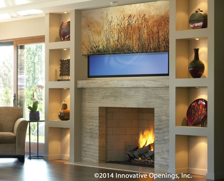 Printed Shades Can Hide Your TV beautifully; here, partially raised so you can see the TV behind the shade detailed to enhance the entire built-in. From Innovative Openings! 303-665-1305