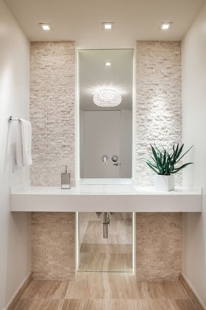 Mirror is divided in two parts (above and below counter) Counter top with sink are made of quartz. There are LED lights recessed behing the two drywalls with stone mosaic.