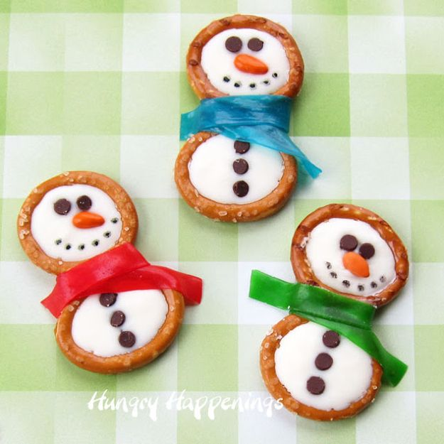 Build candy snowmen with pretzel rings.   30 Adorable Treats To Make When ItSnows