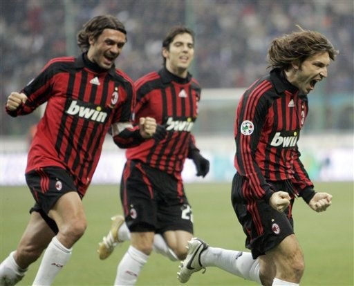 Andrea Pirlo, celebrates with his teammates Paolo Maldini, and Kaka' after scoring, during an Italian major league soccer match against Inter Milan San Siro stadium Sunday, Dec. 23, 2007.