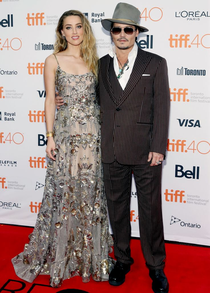 Amber Heard and Johnny Depp contrast in prints.