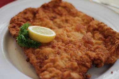 """Wiener schnitzel means """"Viennese Cutlet"""" in German and it's made with breaded and fried veal, chicken or pork cutlets served with fresh lemon juice."""