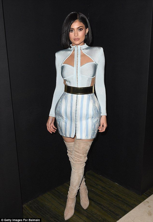 Fashion victim: Kylie Jenner brushed off her bruised feet and scraped legs - due to her heavy metallic dress at the Met Gala earlier that night - as she led the celebrity arrivals at the Balmain afterparty