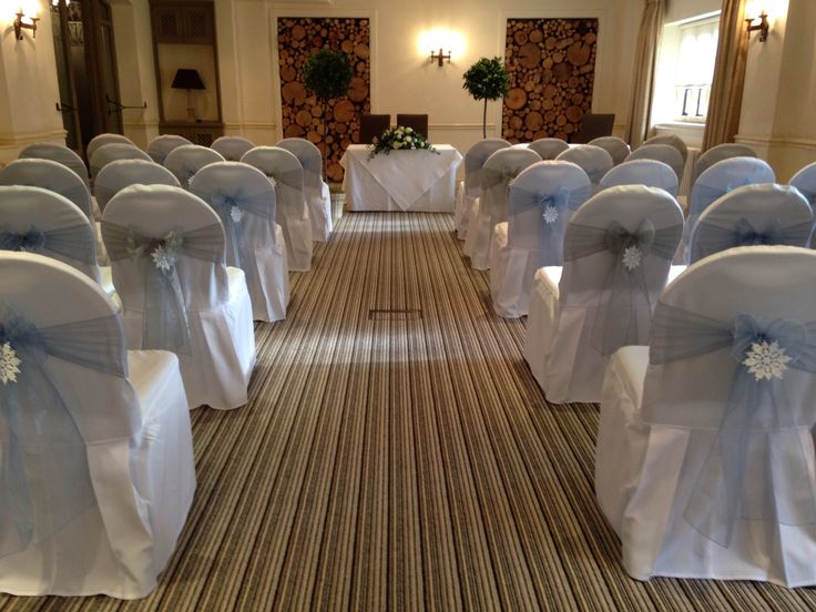 Chair covers with sky blue and silver sashes plus snowflakes