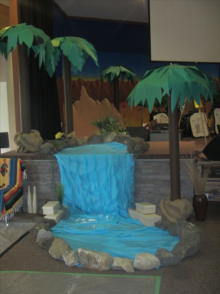 Waterfall is blue plastic tablecloth and streamers. The ...