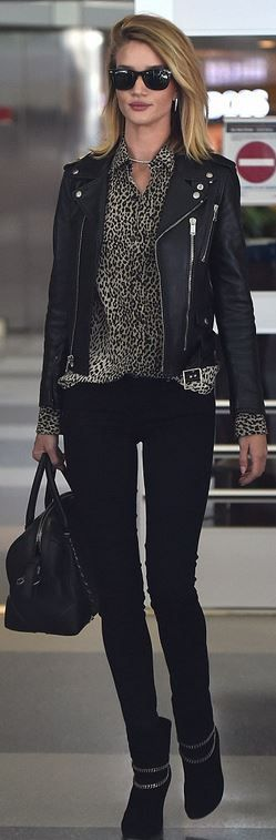 Rosie Huntington-Whiteley: Sunglasses – Ray Ban  Purse – Givenchy  Jeans – Paige  Shoes and jacket – Saint Laurent