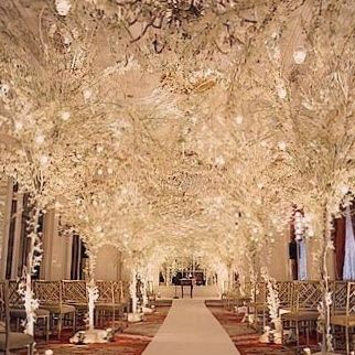 white lit tress in ceremony space