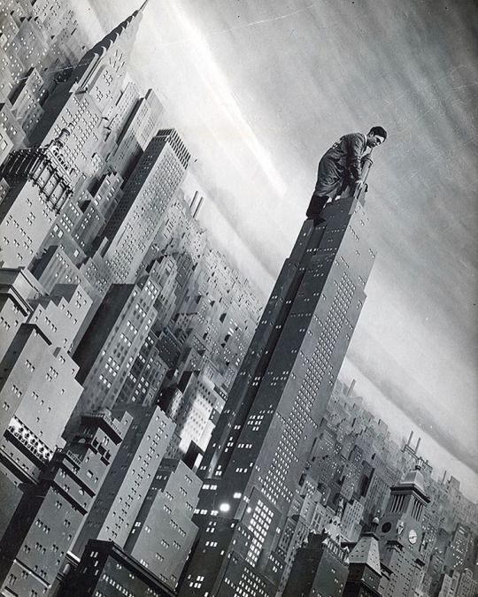 A man working atop 32 foot high replica of the Empire State Building in Consolidated Edison's New York diorama at the World's Fair, 1939.