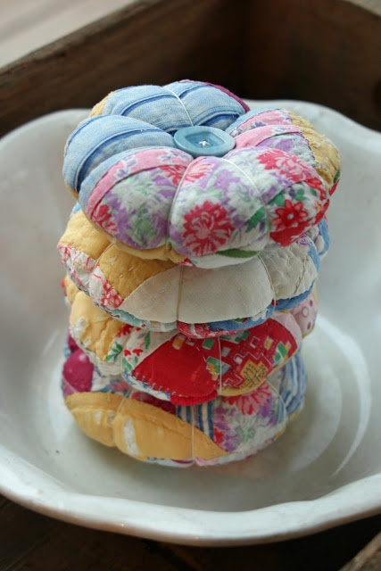 Pin cushions made with vintage quilt scraps -- one way to repurpose an old, worn out quilt -- super cute!/ You could also use just some leftover scraps of fabric to make it look like this.                                                                                                                                                                                 More