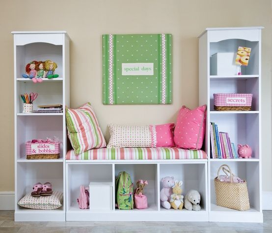 Tame the toy clutter by attaching 3 small bookcases - add a few bins to contain the toys.