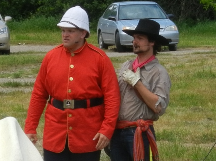 Reenactors portray a Metis interpreter and NorthWest Mounted Police officer, Major Walsh at the 2012 production of The Medicine Line.  http://www.inkwellinspirations.com/2012/08/the-medicine-line-outdoor-show.html