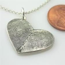 1/2 is your fingerprint 1/2 is his (salt clay paint) Salt Dough - 2 cups flour, 1 cup salt, cold water. Mix until has consistency of play dough. bake at 250 for 2 hours, then cool and paint.good recipe for thumbprint pendants