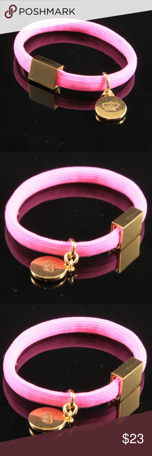 Juicy Couture Candy Pink Elastic Bracelet Juicy Couture Bracelet.  Candy Pink Elastic Band.  Round Juicy Couture Charm. Gold tone.  Used item: any wear shown in pics. Fair condition, with wear consistent with gentle use.  Bundle Up! Offers always welcome :) Juicy Couture Jewelry Bracelets