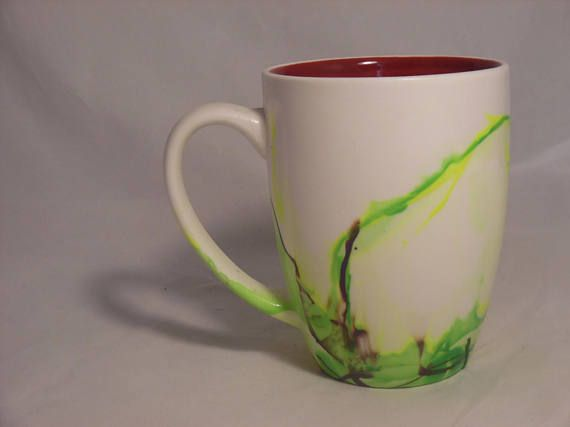 Mug Capacity: 16 Oz.  - Dip dyed marbled white mug. - Sprayed with a sealant, on the outside design only. This sealant makes these items top rack dishwasher safe, however for longer durability, please only hand wash these items. - The mug itself is dishwasher and microwave safe, although I strongly suggest hand washing and avoiding microwave use to preserve the paint.  Each Mug is created individually by hand dipping, never machine printed, so each one will be unique!  Please keep in mind…