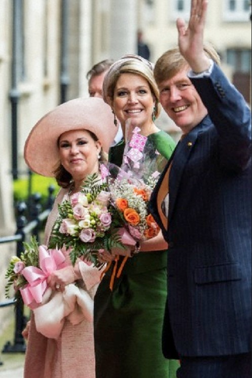 (R-L) Dutch King Willem-Alexander, waves as he and Queen Maxima arrives together with Luxembourg's Grand Duchess Maria-Teresa at the Grand Ducal Palace in Luxembourg on 24 May 2013. The Dutch royals are on a one-day state visit to Luxembourg