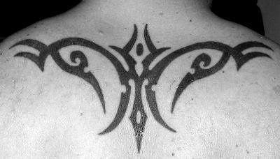 Simple Tribal Tattoo On Upper Back ~ Tribal Tattoo Ideas #58
