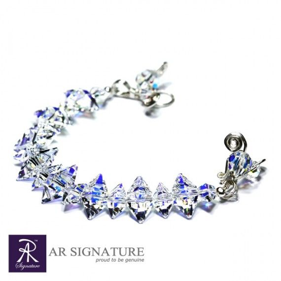 Ice Queen Bracelete, Hancrafted by AR Signature,Jewelry made with Genuine Swarovski® Crystal and Plated wire from USA.  Cool and luxurius looking bracelete that will make you the princess of the hour..  The Crystal are born from the colaboration of Swarovski and Jean Paul Gaultier