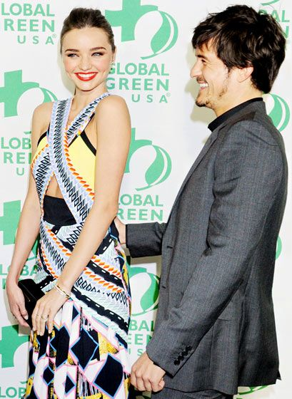 Miranda Kerr & husband Orlando Bloom were giggly & affectionate at Global Green USA's Pre-Oscar party at Avalon in Hollywood
