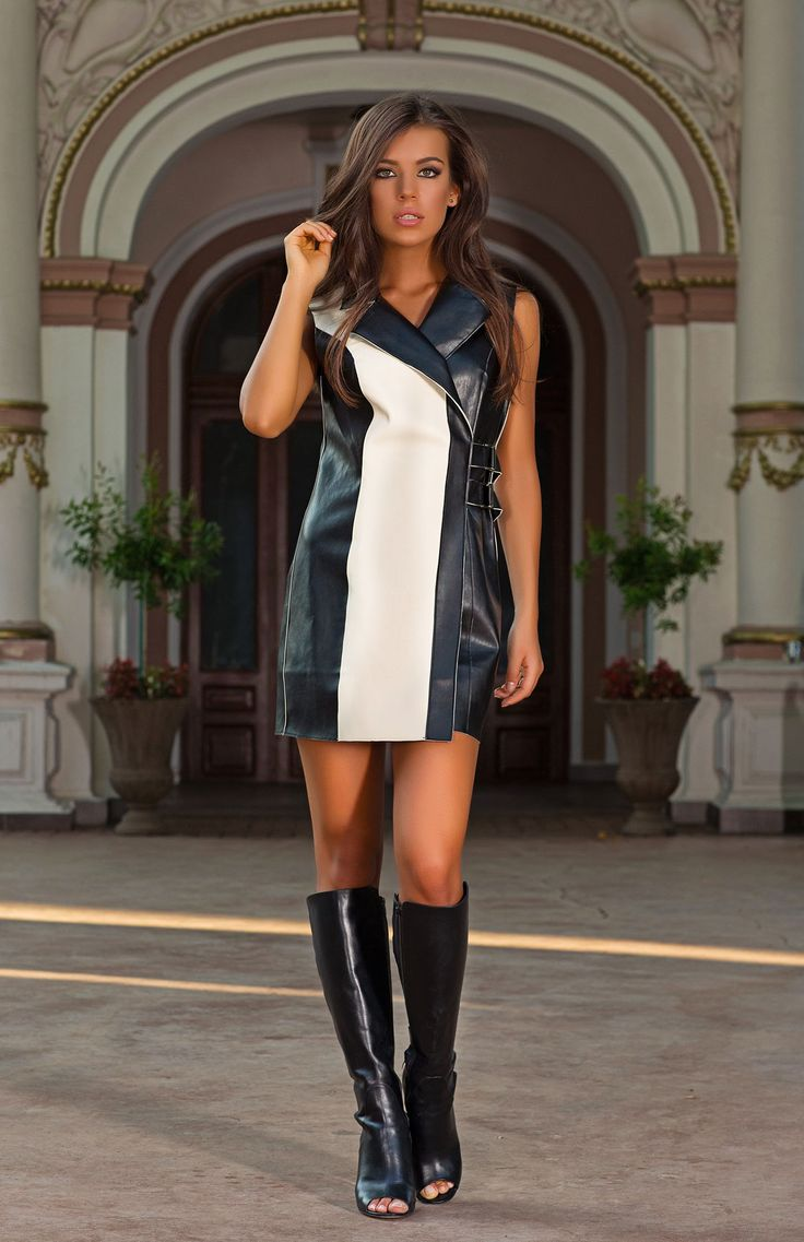 Wear the black and white Cera as a sleeveless jacket layered over fine knits and t-shirts or pair with tights and boots and wear as a mini dress. Soft faux leather and a fitted waist belt flatters the female silhouette.