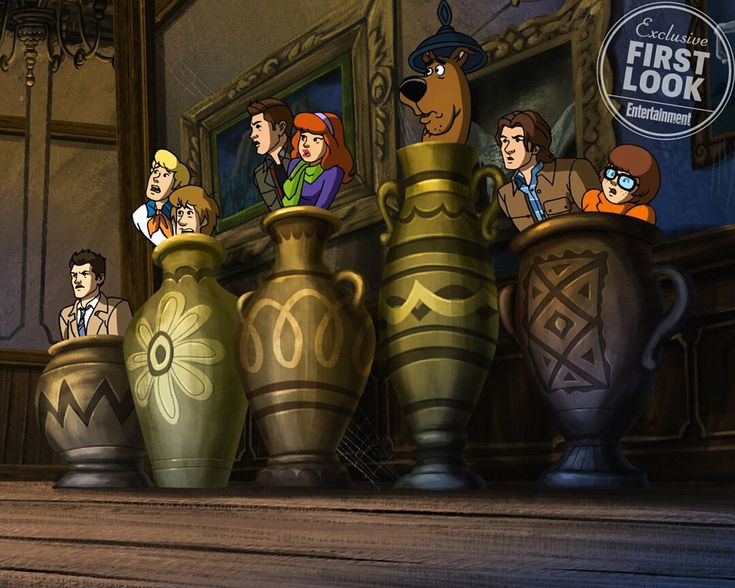 Here's your exclusive first look at the #Supernatural-#ScoobyDoo crossover! Sam, Dean and Castiel meet the Mystery Gang in this new photo