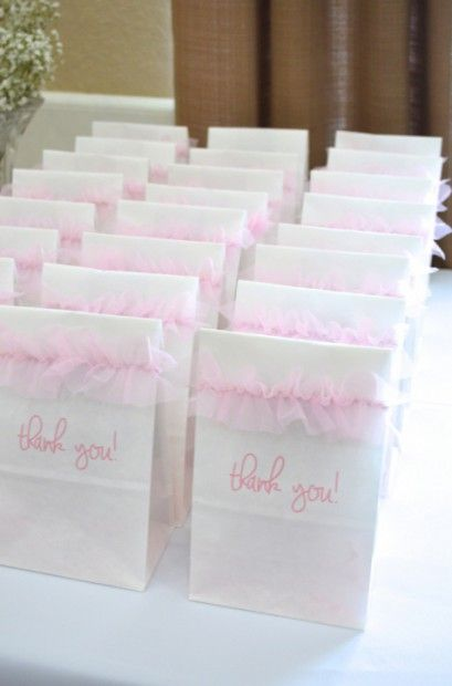 """These take home goody bags I made for my sister's Pink & Gold Ballerina Baby Shower are super-simple to execute and absolutely adorable! All you need are these white paper sandwich bags from your local craft store (I got mine at Michael's), this free font called """"Jennifer Lynne"""" (you can upload here), some double-sided tape, tulle ribbon (I found at... Continue Reading"""