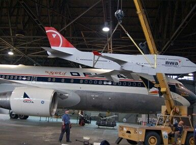 What looks like a cardboard model of the massive boeing 747 400 in northwest airlines paint - Delta airlines hong kong office ...
