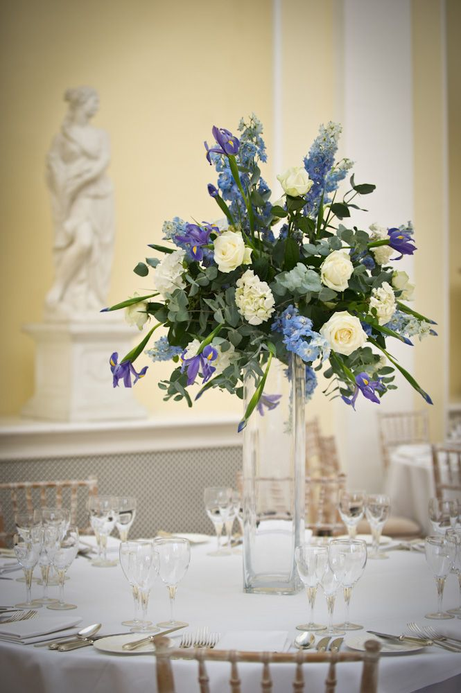 A tall blue and ivory cylinder vase table centre in the Orangery