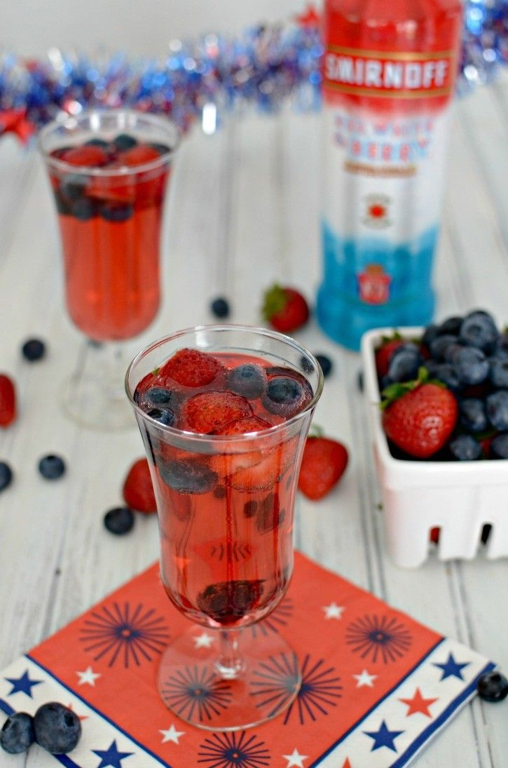 Red, White, and Berry Sparkling Cocktail featuring Smirnoff's Red, White, & Berry Vodka. A perfect cocktail to enjoy while cheering on the USA to gold during the Olympics. Sponsored by Smirnoff.