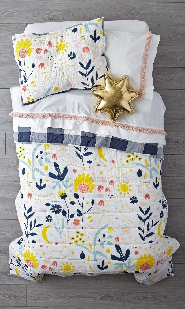 LOVE THIS: Shop Genevieve Gorder Floral Bedding.  Designed just for us by Genevieve Gorder, this bedding features a quilt with a playful floral print on the front and a classic plaid pattern on the back.