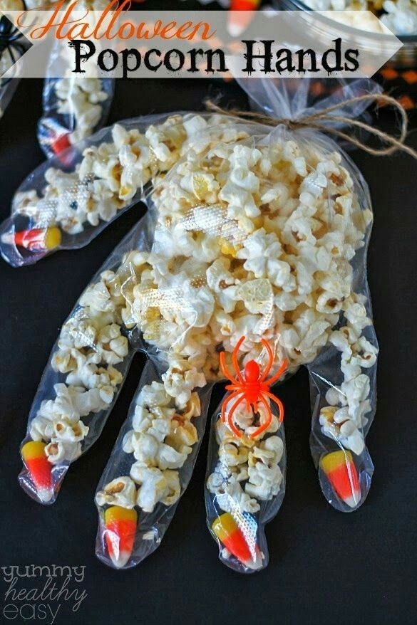 What a cool idea for treats to hand out to trick-or-treaters: DIY Halloween Popcorn Hands! These also work well as party favors for birthdays in October, and for Halloween parties. I love that they're great snacks for kids and adults!