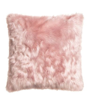 Cushion cover in faux fur with a woven cotton back and a concealed zip.
