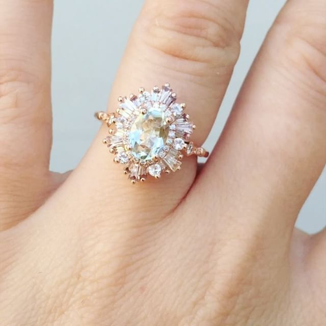 OMG drool. I <3 Heidi Gibson. Beautiful oval hexagon gatsby with shank detailing and an aquamarine centre stone.