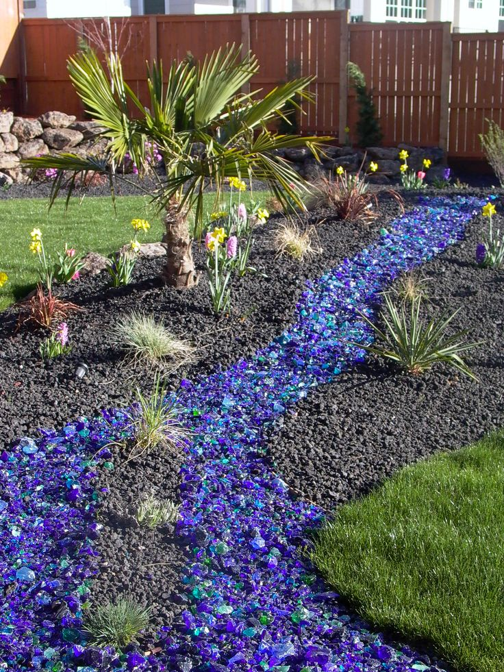Create A River Bed In Your Garden With Recycled Glass Mulch