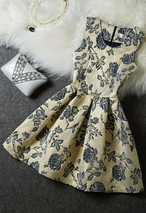 this is my perfect dress - sleeveless, cause i'm always too warm, floral beautiful pattern, fun full skirt. Fashion Embroidered Sleeveless Dress