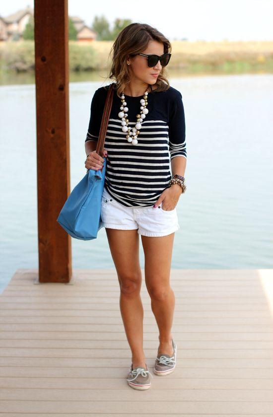 black/white striped tee white shorts neutral flats green handbag multi-strand pearls