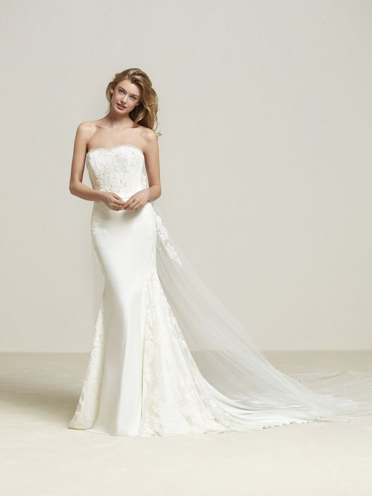 Drenibi: Mermaid style wedding dress with lace, strapless neckline and tulle cape with beautiful appliqués - Pronovias