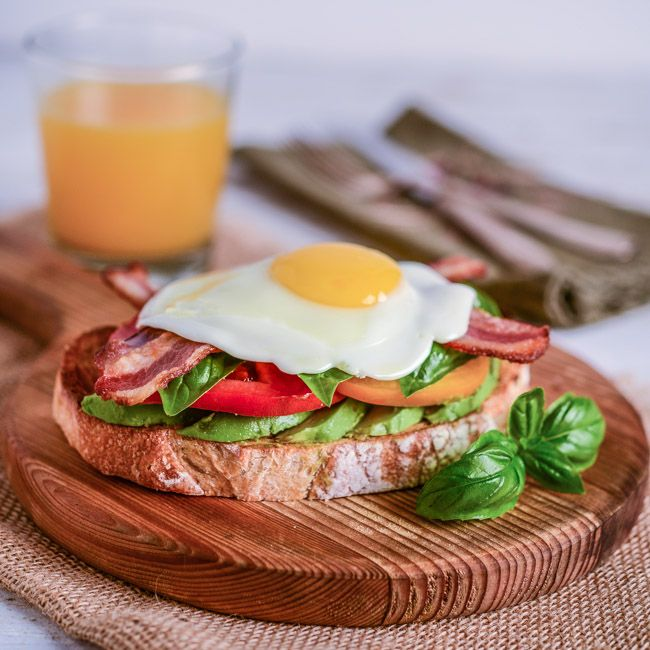 Avocado Toast with Heirloom Tomatoes, Basil, Egg, and Bacon | Recipe