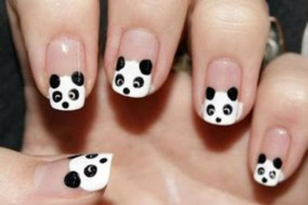 12 Adorable Panda Nail Art Designs - http://slodive.com/nails-2/12-adorable-panda-nail-art-designs/