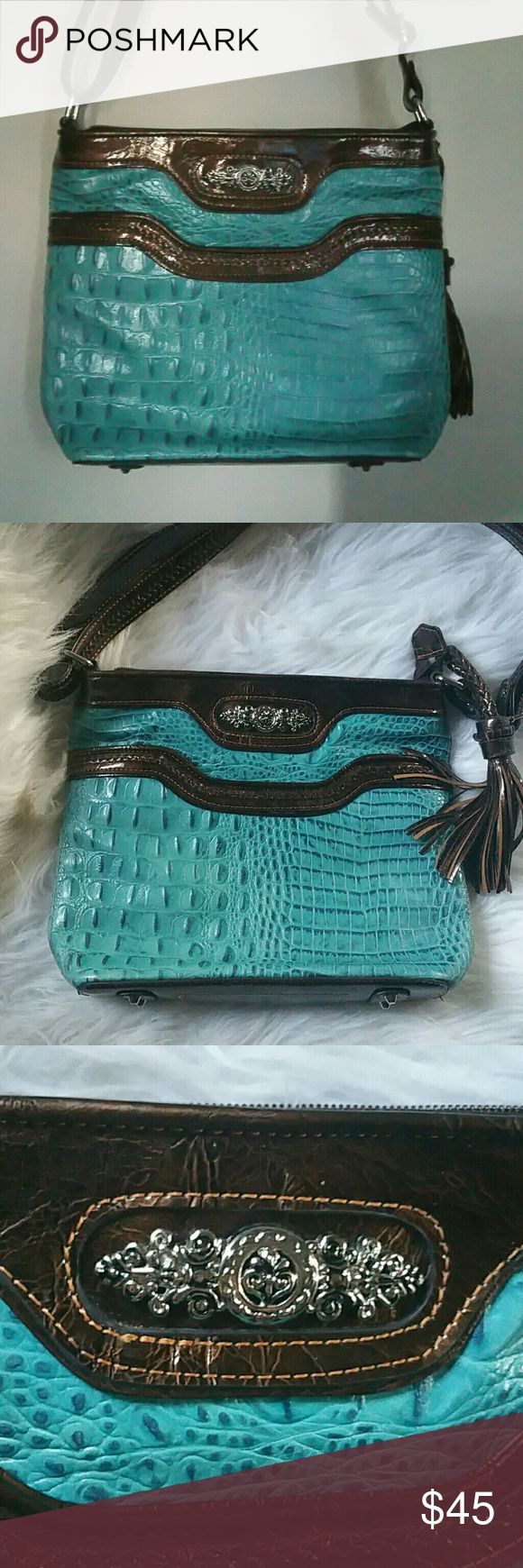 MC MARC CHANTAL - VTG LEATHER EMBOSSED Crossbody or shoulder Aqua blue embossed Tassel zipper pull Silver pegs on bottom Back has zipper n slip pocket Inside has pen holder, slip n zipper pocket, and a velcro snap for keys  This bag was never used Has been sitting in my closet So actually cam call it BNWOT  Inside n out are perfect  I ship same day ?? MC Marc Chantal Bags