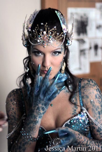 Yes.  This is the kind of face makeup/adornments I would LOVE.  Not that creepy hands, though.  XD