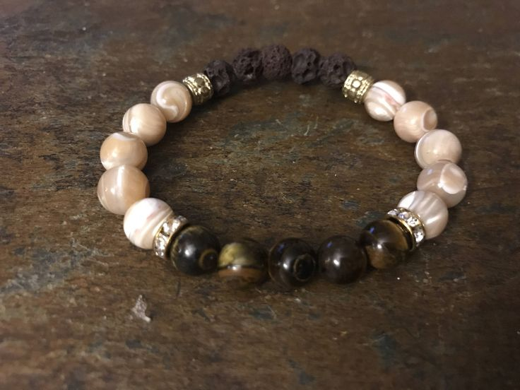A personal favorite from my Etsy shop https://www.etsy.com/ca/listing/563686235/oli-diffusing-lava-bead-bracelet-with