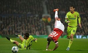 Georgi Schennikov takes out Manchester United's Ashley Young and gets himself in the referee's book.