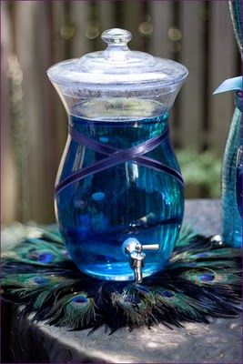 I love the feather coasters/doilies (what would you call them?), but drinking blue Kool-Aid at a wedding seems strange...and there is no doubt my white dress would end up blue!