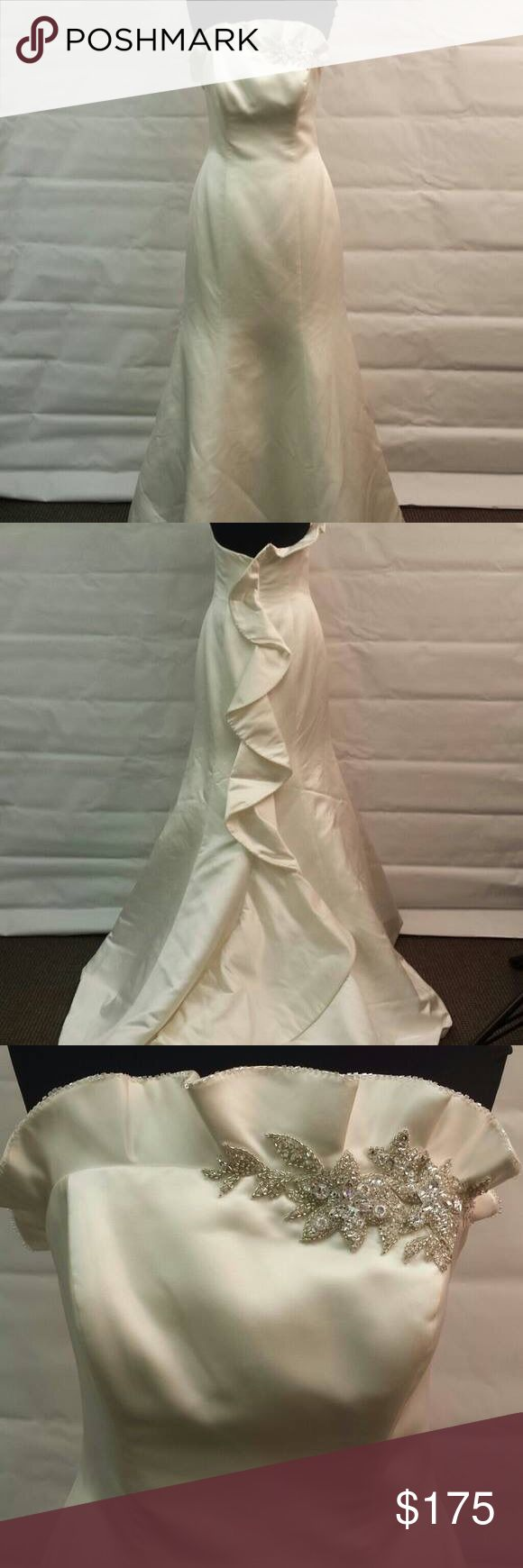 Galina Signature Wedding Gown Size 10. Ivory satin. Strapless gown with ruffle and rhinestone detailing. Gently worn. Will include a raw-edge chapel-length veil. David's Bridal Dresses Wedding