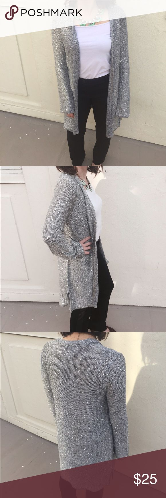 Long Silver Sequin Cardigan Long sleeve, knee length, silver cardigan with micro sequins interwoven in the top. White House Black Market Sweaters Cardigans