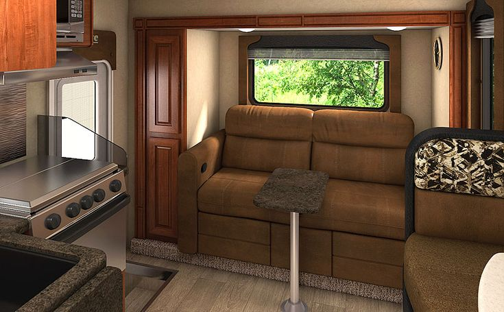 Kick out sofa in the Lance 1172, http://www.truckcampermagazine.com/news/2017-lance-camper-announcements/