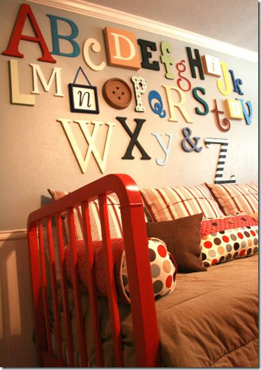 I would love this in Carter's room.  The best part is that they are all different fonts and materials ~Tara