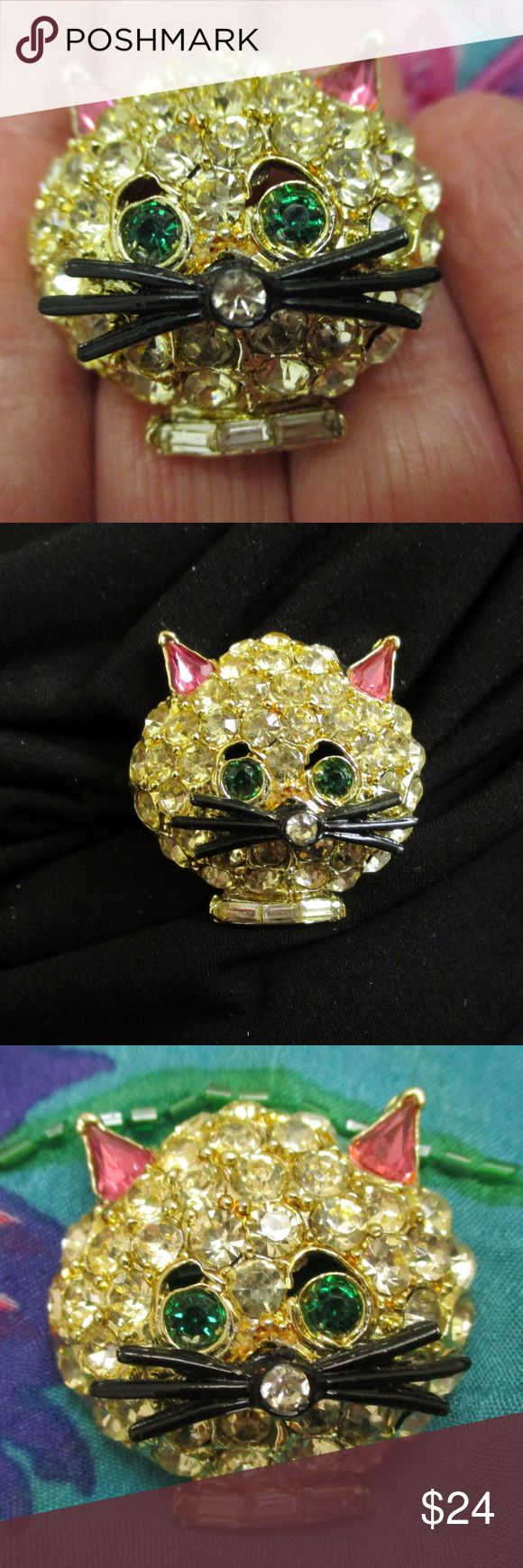 """Viintage Pave Set Rhinestone Feline Cat Brooch Glittering vintage pave set rhinestone cat kitten brooch.  Clear faceted crystal rhinestones are pave set into gold tone metal. Two faceted green rhinestone eyes, pink faceted teardrop ears, six black enamel cat whiskers and three clear baguette rhinestone collar complete this charming feline pin. 1 3/8"""" x 1 1/2"""" x 1/2"""" deep. Secure rollover clasp. Perfect three-dimensional brooch for the cat lover or collector of figural jewelry. Photos cannot…"""