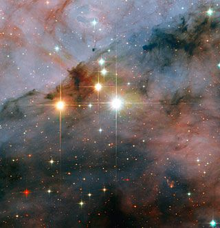 Mammoth stars seen by Hubble. The image shows a pair of colossal stars, WR 25 and Tr16-244, located within the open cluster Trumpler 16. This cluster is embedded within t...
