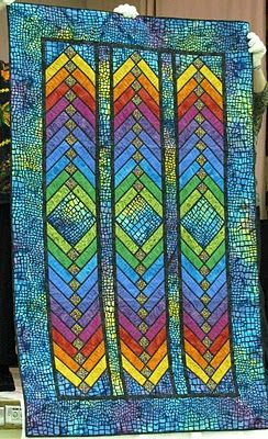 A gorgeous French braid quilt by Jane Hardy Miller - reminds me of stained glass. From the blog The Secret Life of Mrs. Meatloaf